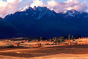 PERU, HIGHLAND, ANDES MOUNTAINS the Cordillera de Urubamba Mtn. s above fields at Maras near Cuzco