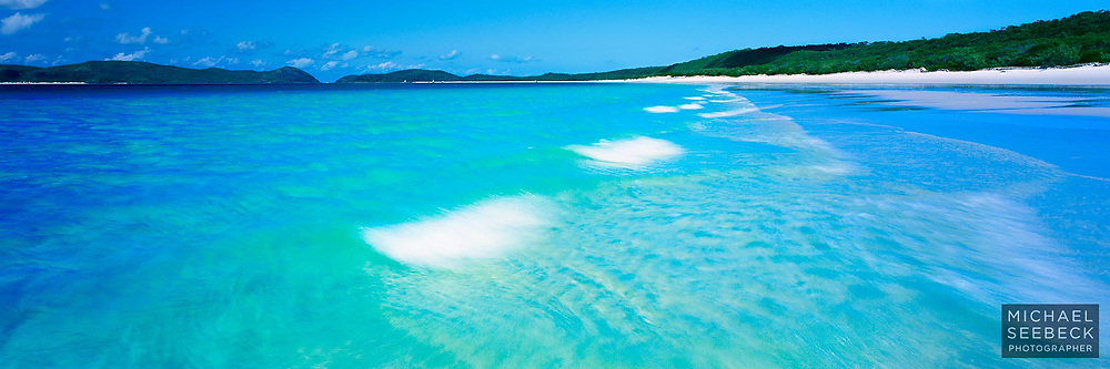 Small waves wash up on the beautiful Whitehaven Beach on Whitsunday Island, in the Whitsundays.<br /> <br /> Limited Edition Print