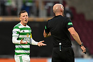 Callum McGregor (#42) of Celtic FC speaks with referee Bobby Madden during the Cinch SPFL Premiership match between Heart of Midlothian FC and Celtic FC at Tynecastle Park, Edinburgh, Scotland on 31 July 2021.