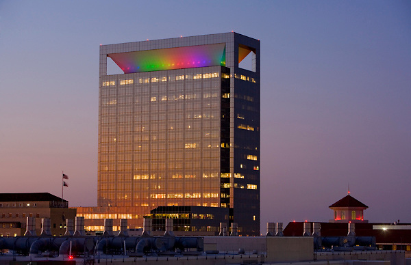 Memorial Hermann Medical Plaza with colorful lights in Houston's Texas Medical Center at dusk.