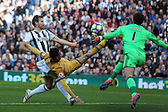 Dele Alli of Tottenham Hotspur is denied by a save from West Brom goalkeeper Ben Foster and then takes a boot to his face in the challenge. Premier league match, West Bromwich Albion v Tottenham Hotspur at the Hawthorns stadium in West Bromwich, Midlands on Saturday 15th October 2016. pic by Andrew Orchard, Andrew Orchard sports photography.