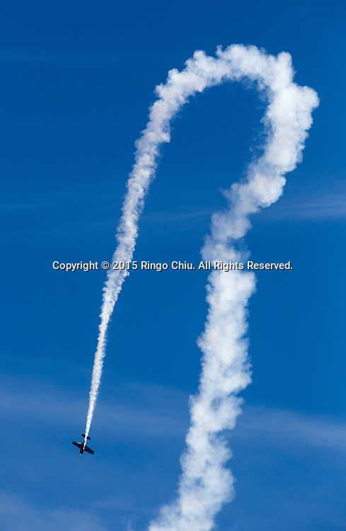 Chuck Coleman, Extra 300, performs during Los Angeles County Air Show in Lancaster, California on March 21, 2015. (Photo by Ringo Chiu/PHOTOFORMULA.com)
