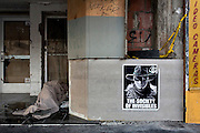 A homeless man sleeping in front of a bankrupt photography store on Hollywood Boulevard. COPYRIGHT JURRIAAN BROBBEL