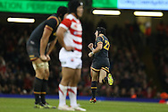 Sam Davies of Wales (22) celebrates after he scores a late drop goal to win the match. Under Armour 2016 series international rugby, Wales v Japan at the Principality Stadium in Cardiff , South Wales on Saturday 19th November 2016. pic by Andrew Orchard, Andrew Orchard sports photography
