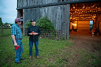 6/8/19 9:09:02 PM -- Boyd, Kentucky -- Neil Rush and Jack Gruber speak outside during a party in the barn following the 2019 lighting workshop.  --    Photo by Jasper Colt