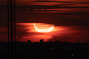 June 10, 2021 - Sunrise Annular Eclipse with George Washington Bridge in the foreground, viewed from Fort Lee Historic Park, Palisades Interstate Park Commission.