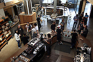 Patrons sip coffee inside Sightglass Coffee Bar and Roastery on Seventh Street in San Francisco, CA on November 1, 2011.