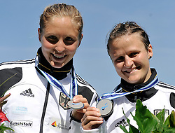 CAROLIN LEONHARDT & SILKE HOERMANN (BOTH GERMANY) POSE WITH THEIR SILVER MEDALS IN WOMEN'S K2 1000 METERS FINAL A RACE DURING 2010 ICF KAYAK SPRINT WORLD CHAMPIONSHIPS ON MALTA LAKE IN POZNAN, POLAND...POLAND , POZNAN , AUGUST 21, 2010..( PHOTO BY ADAM NURKIEWICZ / MEDIASPORT ).