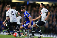 Diego Costa of Chelsea © goes past Mousa Dembele ® and Toby Alderweireld of Tottenham Hotspur . Barclays Premier league match, Chelsea v Tottenham Hotspur at Stamford Bridge in London on Monday 2nd May 2016.<br /> pic by Andrew Orchard, Andrew Orchard sports photography.