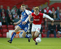 Photo. Andrew Unwin<br /> Rotherham v Millwall, Nationwide League Division One, Millmoor Lane, Rotherham 11/10/2003.<br /> Rotherham's Chris Sedgwick (r) holds off Millwall's Tony Craig (l).