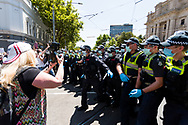 Riot officers break the circle to arrest protesters during the Melbourne Freedom Rally at Parliament House. Police move into position on the steps of state parliament ahead of a planed protest. The groups who have organised the many Freedom Day protests over the last 3 months, attempted to march on State Parliament during Melbourne Cup Day demanding the sacking of Premier Daniel Andrews for the lockdown and attacks on their civil liberties. Police met with the protester's with significant force despite the city having had zero cases for five days. (Photo by Dave Hewison/Speed Media)