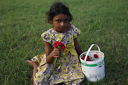 August 26, 2017 - Dhaka, Bangladesh - Shumaya, who age is 7, sells flowers at a park in Dhaka. (Credit Image: © Md. Mehedi Hasan via ZUMA Wire)