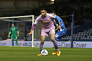 Reading midfielder Hal Robson-Kanu (9) holds off Brighton winger, Jamie Murphy (15) during the Sky Bet Championship match between Brighton and Hove Albion and Reading at the American Express Community Stadium, Brighton and Hove, England on 15 March 2016. Photo by Geoff Penn.