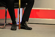 Judd Trump of England's shoes during his match v Jamie Burnett of Scotland . Bet Victor Welsh Open snooker at the Newport centre in Newport, South Wales on Monday 24th Feb 2014.<br /> pic by Andrew Orchard, Andrew Orchard sports photography.