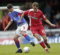 Photo: Jonathan Butler.<br />Swindon Town v Carlisle United. The FA Cup. 11/11/2006.<br />Andy Nicholas of Swindon fights off Derek Holmes of Carlisle.