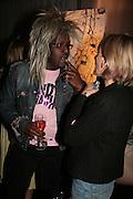Orlando Hamilton and Ingrid Tarrant, Laurent Perrier Pop Art Pink party. Suka at Sanderson. Berners St. London. 25 April 2007.  -DO NOT ARCHIVE-© Copyright Photograph by Dafydd Jones. 248 Clapham Rd. London SW9 0PZ. Tel 0207 820 0771. www.dafjones.com.