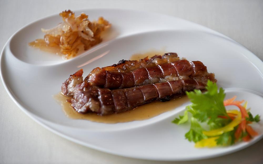 06 July 2009, Macau, China ---  Iberico Barbacue Pork dish. Photo by Victor Fraile --- Image by © Victor Fraile/Corbis