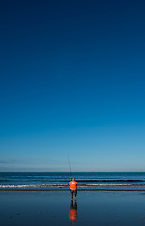 © Licensed to London News Pictures. <br /> 12/10/2014. <br /> <br /> Saltburn, United Kingdom<br /> <br /> A fisherman takes part in the annual Jim Maidens memorial beach fishing competition in Saltburn by the Sea in Cleveland. <br /> The competition is held each year to mark the death of Saltburn plumber and keen fisherman Jim Maidens who died in 1998 when he was killed after being swept overboard from his boat 'Corina' close to the beach at Saltburn.<br /> <br /> Photo credit : Ian Forsyth/LNP