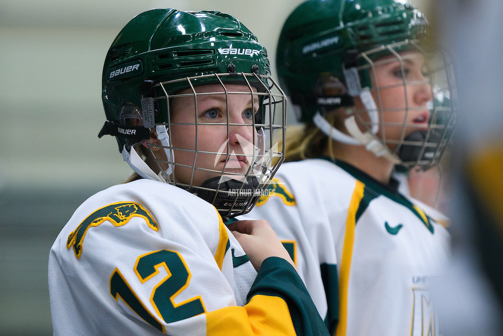 1st year forward Chelsea Hallson (12) of the Regina Cougars in action during the Women's Hockey Game on November 25 at Co-operators arena. Credit: Arthur Ward/Arthur Images