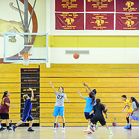 061015  Adron Gardner/Independent<br /> <br /> A jump shot goes up during basketball camp scrimmage at Tohatchi High School Wednesday.