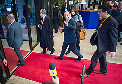 Francois Hollande, France's president, waves to members of the media as he departs, following the conclusion of the EU Summit, at the European Council headquarters in Brussels, Belgium on Friday, Dec. 14, 2012. (Photo © Jock Fistick)