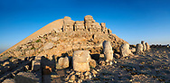 Statue heads, from left,  Eagle, Antiochus, Commagene, Zeus, Apollo, & Herekles with headless seated statues in front of the stone pyramid 62 BC Royal Tomb of King Antiochus I Theos of Commagene, east Terrace, Mount Nemrut or Nemrud Dagi summit, near Adıyaman, Turkey