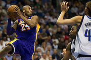 Kobe Bryant (24) of the Los Angeles Lakers passes the ball against the Dallas Mavericks at the American Airlines Center in Dallas on Sunday, February 24, 2013. (Cooper Neill/The Dallas Morning News)