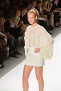 White mini-dress with lace top. By Zang Toi, shown at his Spring 20132 Fashion Week show in New York.
