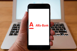Using iPhone smartphone to display logo of Alfa Bank ; the largest private commercial bank in Russia