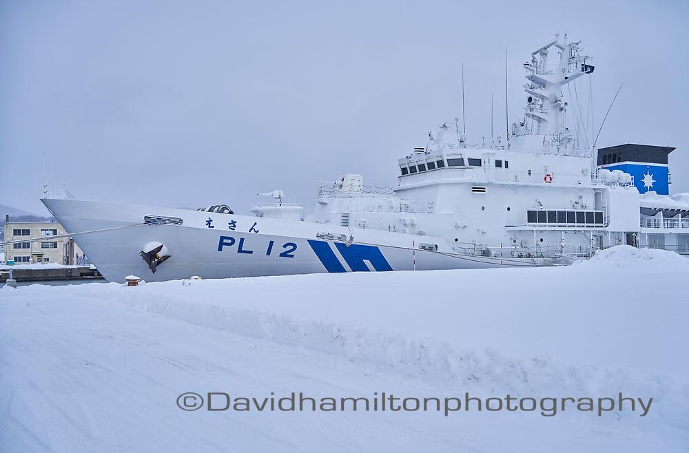 Japanese Navy coastal patrol boat at port, Otaru, Hokkaido Japan in winter.
