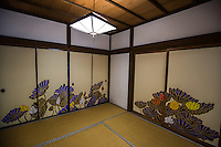 """Tatami originally means """"folded and piled"""" and are a traditional type of Japanese flooring. Traditionally made of rice straw to form the core though nowadays sometimes the core is composed of compressed wood chips or polystyrene foam, with a covering of woven rush straw. Usually, on the long sides, they have edging of brocade.  In almost all Japanese homes, temples and restaurants, one can find fusuma, which slide from side to side to redefine spaces within a room, and also act as doors. They typically measure about the same size as a tatami mat, and are two or three centimeters thick. They consist of a wooden frame, covered in cardboard and a layer of paper. They typically have a black lacquer border and an indented door handle. Historically, fusuma were painted, often with scenes from nature such as mountains, forests or animals."""