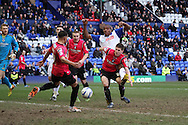 Tranmere Rovers' Stephen Arthurworrey sees his shot blocked. Skybet football league 1match, Tranmere Rovers v Oldham Athletic at Prenton Park in Birkenhead, England on Saturday 1st March 2014.<br /> pic by Chris Stading, Andrew Orchard sports photography.