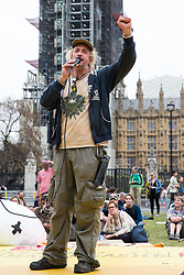 London, UK. 23rd April 2019. Activist Phoenix addresses fellow climate change activists from Extinction Rebellion at an assembly in Parliament Square to discuss the preparation and delivery of activists' letters requesting meetings to discuss climate change with Members of Parliament.