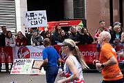 Uber joke placard at the London Marathon on 28th April 2019 in London, England, United Kingdom. The London Marathon, presently known through sponsorship as the Virgin Money London Marathon, is a long-distance running event. The event was first run in 1981 and has been held in the spring of every year since. The race is mainly known for ebing a public race where ordinary people can challenge themsleves while raising great amounts of money for various charities.