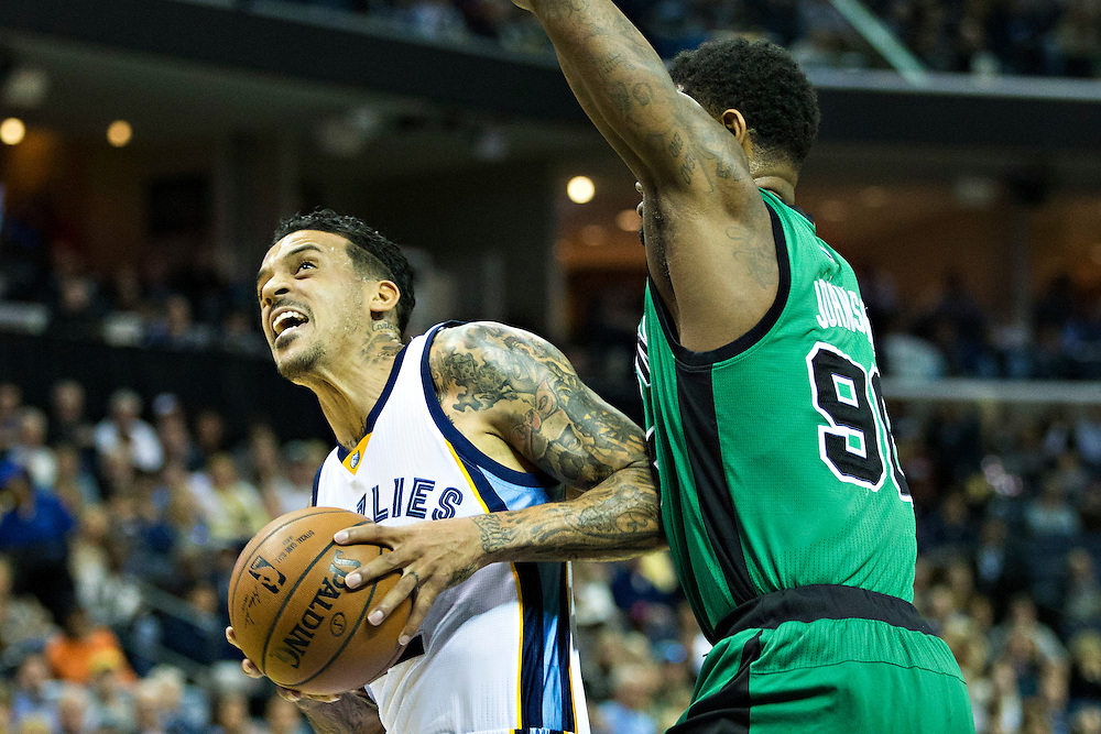 MEMPHIS, TN - JANUARY 10:  Matt Barnes #22 of the Memphis Grizzlies goes for a shot against Amir Johnson #90 of the Boston Celtics at the FedExForum on January 10, 2016 in Memphis, Tennessee.  The Grizzlies defeated the Celtics 101-98.  NOTE TO USER: User expressly acknowledges and agrees that, by downloading and or using this photograph, User is consenting to the terms and conditions of the Getty Images License Agreement.  (Photo by Wesley Hitt/Getty Images) *** Local Caption *** Matt Barnes; Amir Johnson