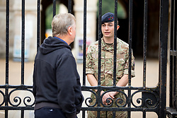 © Licensed to London News Pictures. 16/09/2017. London, UK. A soldier speaks to a member of the public following a terror attack in Parsons Green, West London yesterday (Friday) morning. Last night, British Prime Minister Theresa May raised the terror threat level from severe to critical. The terror suspect is still at large. Photo credit : Tom Nicholson/LNP