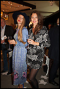 LISA URLA (L), JULIA FLIT (R) at the preview of LAPADA Art and Antiques Fair. Berkeley Sq. London. 23 September 2014.