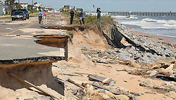 October 8, 2016 - Flagler Beach, FL, USA - Flagler County Sheriff's Commander James Troiano, middle, gives a media tour of a section of A1A that was washed out in Flagler Beach, Fla., on Saturday, Oct. 8, 2016, after Hurricane Matthew devastated the area. (Credit Image: © Stephen M. Dowell/TNS via ZUMA Wire)