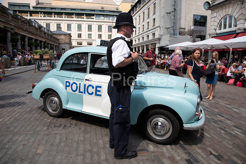 Vintage Morris Minor police car in London, United Kingdom. The Morris Minor is a British car of which more than 1.6million were manufactured between 1948 and 1972. Initially available as a two-door saloon, the range was expanded to include a four-door saloon. It was the first British car to sell over one million units and is considered a classic example of automotive design, as well as typifying Englishness.