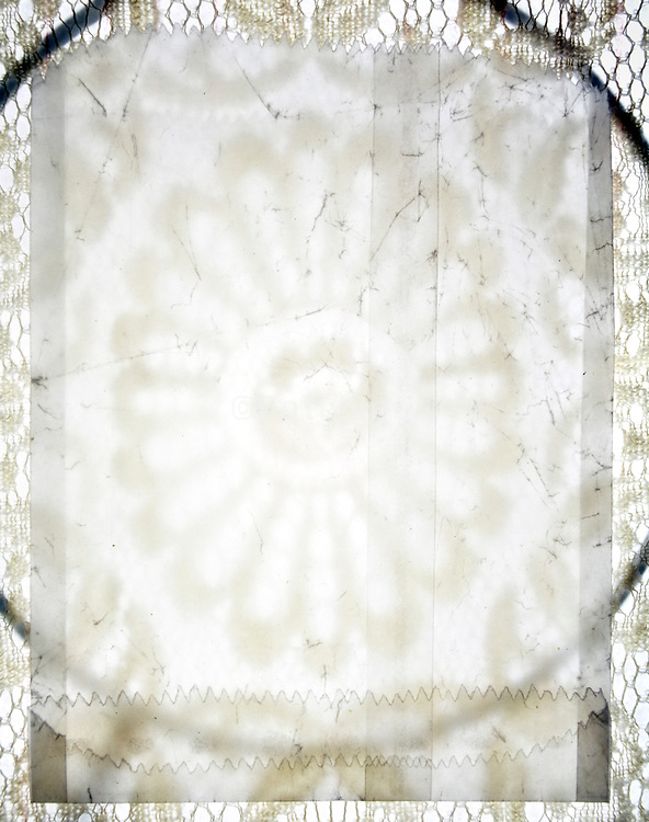 open semi transparent envelopes on lace fabric