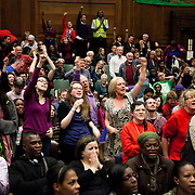 Resistance: The best Olympic Spirit. With John Carlos, Doreen Lawrence, Janet Alder and others. The audience join in and salute John Carlos and the other speakers at the end of the night. The event was organised by the RMT and the Fire brigade Union in connection with John Carlos' visit from the United States.  John Carlos won Bronze in the 200 Olympics final in 1968 in Mexico. He and his fellow black American runner, Tommie Smith who won Gold, raised their black gloved fists, wearing no shoes, on the podium to highlight the plight of black Americans. Both lost their medals and were expelled from the American Olympic team and sent home where they faced years of death threats and struggling to keep their careers going. The image of the two men became an iconic symbol of standing up against oppression not just for black Americans but worldwide.