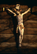 Wooden crucifix mounted on barn wall of small farm in Principality of Liechtenstein.
