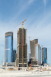 Many high-rise toffice and apartment towers under construction  on Al Reem Island new CBD in Abu Dhabi United Arab emirates.