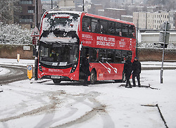 © Licensed to London News Pictures. 24/01/2021. London, UK. A London bus stuck on a slope in Swiss Cottage, North London following heavy snowfall. Parts of the UK continue to suffer from flooding caused by Storm Christoph. Photo credit: Ben Cawthra/LNP