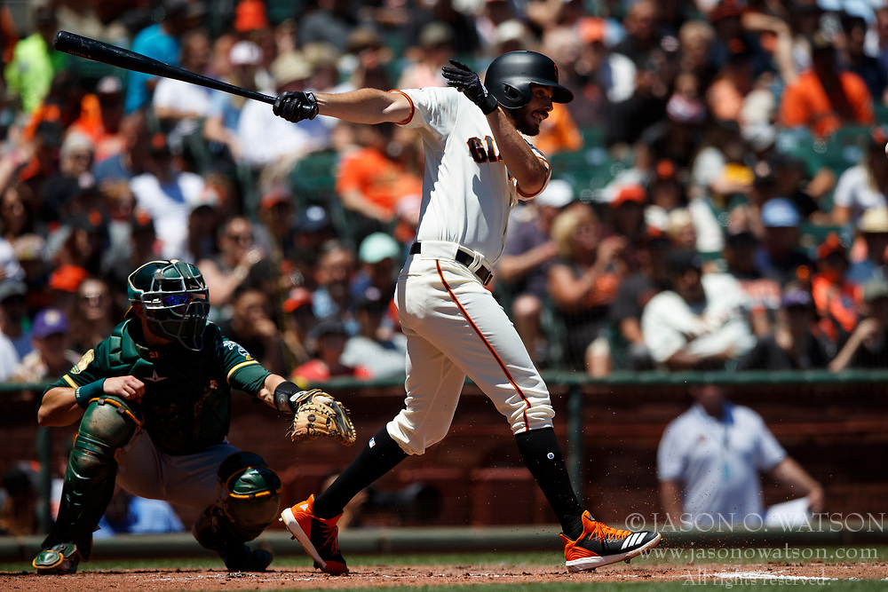 SAN FRANCISCO, CA - JULY 15: Andrew Suarez #59 of the San Francisco Giants at bat against the Oakland Athletics during the third inning at AT&T Park on July 15, 2018 in San Francisco, California. The Oakland Athletics defeated the San Francisco Giants 6-2. (Photo by Jason O. Watson/Getty Images) *** Local Caption *** Andrew Suarez