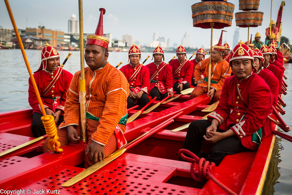 06 NOVEMBER 2012 - BANGKOK, THAILAND:  Oarsmen on the Royal Barge Suphannahong on the Chao Phraya River, after the dress rehearsal for the Royal Barge Procession. Thailand's Royal Barge Procession has both religious and royal significance. The tradition is nearly 700 years old. The Royal Barge Procession takes place rarely, typically coinciding with only the most important cultural and religious events. During the reign of King Bhumibol Adulyadej, spanning over 60 years, the Procession has only occurred 16 times. The Royal Barge Procession consists of 52 barges: 51 historical Barges, and the Royal Barge, the Narai Song Suban, which King Rama IX built in 1994. It is the only Barge built during King Bhumibol's reign. These barges are manned by 2,082 oarsmen. The Procession proceeds down the Chao Phraya River, from the Wasukri Royal Landing Place in Bangkok, passes the Grand Palace complex and ends at Wat Arun. Tuesday's dress rehearsal was the final practice for the 2012 Royal Barge Procession, which takes place November 9.    PHOTO BY JACK KURTZ