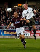 Photo: Richard Lane.<br />Northampton Town v Bristol City. Coca Cola League 1. 29/08/2006. <br />City's Steve Brooker gets above Sean Dyche to head the ball.