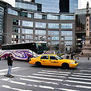 Taxis and skateboarder on Columbus Circle in Manhattan