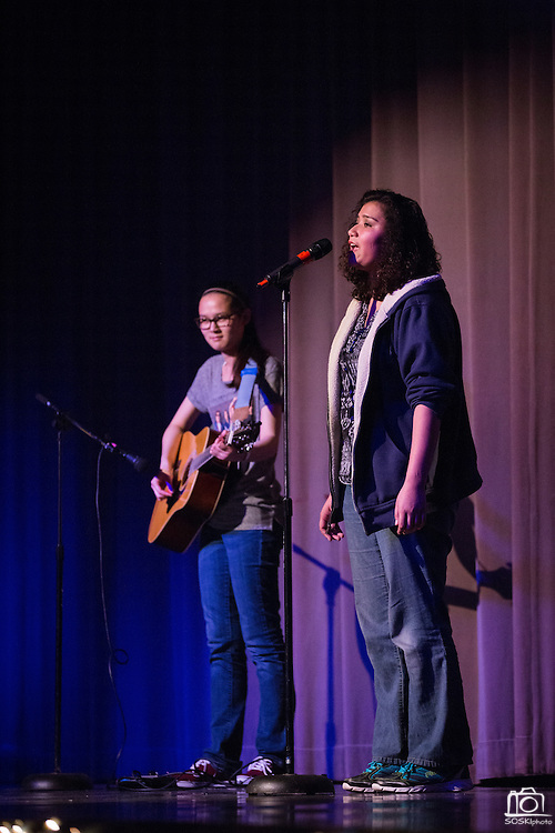 Alexis Tran and Julisa Flores, right, perform a duet during the Milpitas High School Talent Show at Milpitas High School in Milpitas, California, on February 5, 2016. (Stan Olszewski/SOSKIphoto)