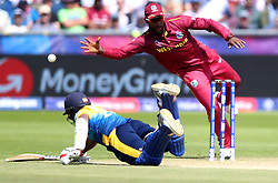 Sri Lanka's Avishka Fernando dives as he is nearly run out during the ICC Cricket World Cup group stage match at The Riverside Durham, Chester-le-Street.